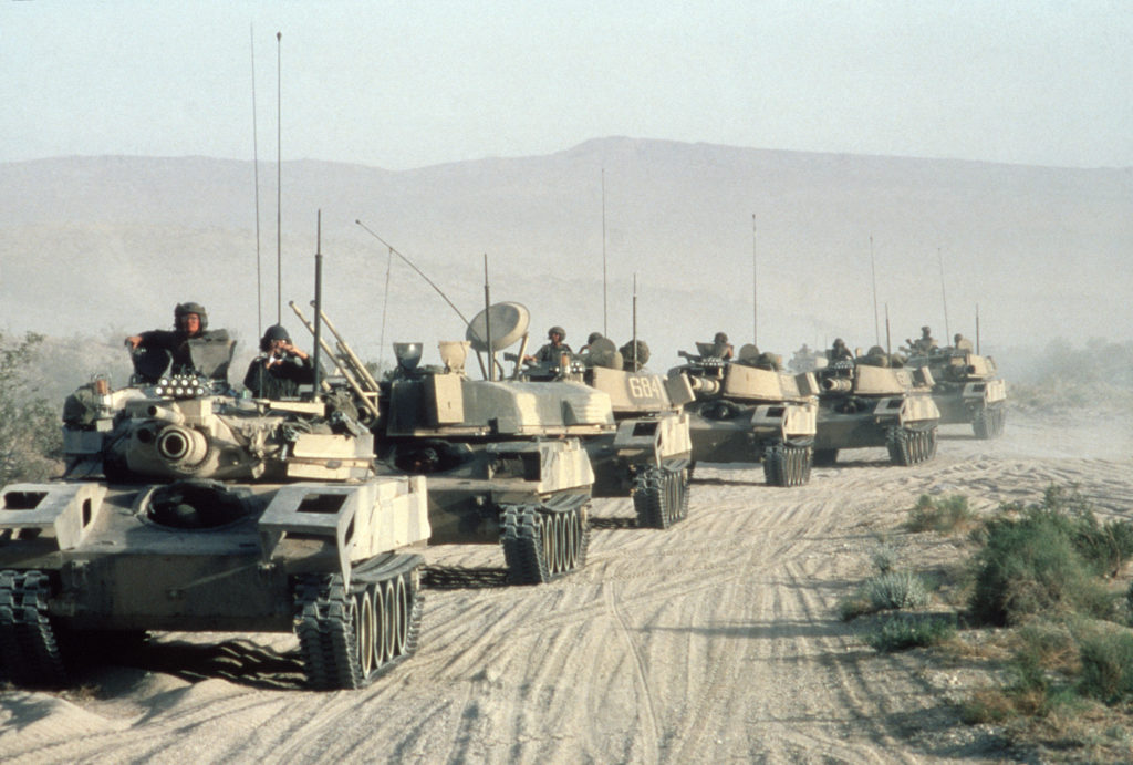 M551 Sheridan light tanks cross the desert during an Opposing Forces exercise at the National Training Center. The tanks have visual modifications designed to make it resemble Soviet armor.